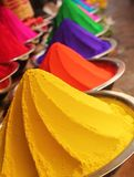 Colorful piles of powdered dyes on display. Colorful piles of powdered dyes used for holi festival on display in an indian shop at mysore Royalty Free Stock Image