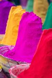 Colorful piles of powdered dyes used for Holi festival Stock Images