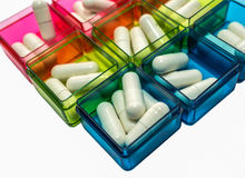 Colorful pill boxes Royalty Free Stock Image
