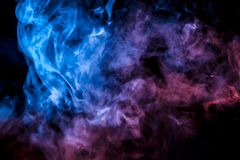A colorful pillar of blue, pink and purple smoke evaporates with thin jets rising to the top on a black background in light stock illustration