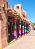 The Plaza in Santa Fe, New Mexico. Colorful pillars line the sidewalk along one of the historic buildings in the center plaza in Santa Fe, New Mexico stock image