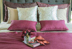 Colorful Pillow and decorative tray on the bed Stock Images