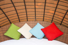 Colorful Pillow on hotel bed Stock Photos