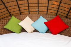 Colorful Pillow on hotel bed Stock Images