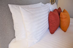 Colorful Pillow on hotel bed with space for text Royalty Free Stock Photography
