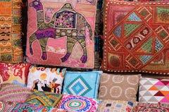 Colorful pillows at an Arab bazaar. Oriental cushions. National textile bazaar in Dubai Royalty Free Stock Photography