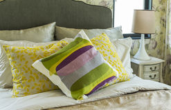 Colorful pillows on bed Stock Photos