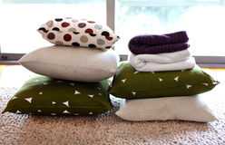 Colorful pillows and blankets on the woolen carpet Royalty Free Stock Photos