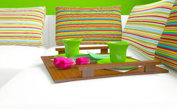 Colorful pillows and coffee on the sofa. Stock Photography