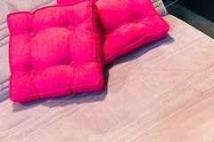 Colorful pillows on hotel bed Royalty Free Stock Images