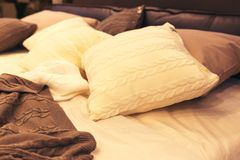 Colorful pillows on hotel bed Royalty Free Stock Photo