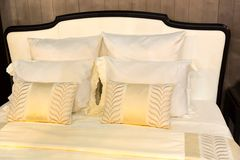 Colorful pillows on hotel bed Royalty Free Stock Image