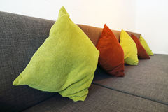 Colorful pillows on long sofa for pattern and background Royalty Free Stock Photo