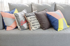 Colorful pillows on modern grey sofa in living room Royalty Free Stock Photography