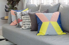 Colorful pillows on modern grey sofa in living room Stock Photography