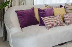 Colorful pillows on modern sofa in living room Royalty Free Stock Photo