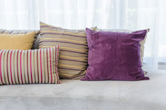 Colorful pillows on modern sofa in living room Royalty Free Stock Image