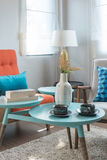 Colorful pillows and round table in modern living room Stock Photo