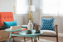 Colorful pillows and round table in modern living room Royalty Free Stock Photos