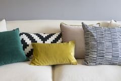Colorful pillows on sofa in modern living room. Close up of colorful pillows on sofa in modern living room Royalty Free Stock Photo