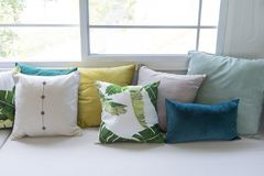 Colorful pillows on sofa in modern living room. Close up of colorful pillows on sofa in modern living room Stock Photography