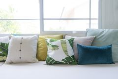 Colorful pillows on sofa in modern living room. Close up of colorful pillows on sofa in modern living room Stock Images
