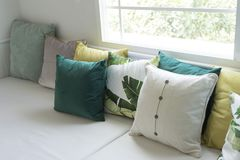 Colorful pillows on sofa in modern living room. Close up of colorful pillows on sofa in modern living room Stock Photo