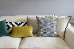 Colorful pillows on sofa in modern living room. Close up of colorful pillows on sofa in modern living room Royalty Free Stock Photos