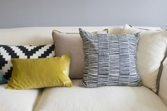 Colorful pillows on sofa in modern living room. Close up of colorful pillows on sofa in modern living room Stock Image