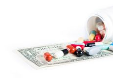 Colorful pills on american dollar Royalty Free Stock Photography