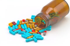 Colorful pills and bottle tablets on white background Royalty Free Stock Image