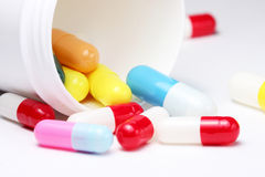 Colorful pills with can. Colorful capsules high key on white Royalty Free Stock Photos