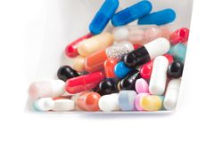 Colorful pills in the container Royalty Free Stock Photography