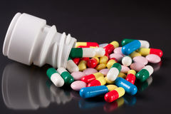 Colorful pills on a dark background Stock Images