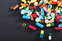Colorful pills. Different colorful pills on black background Royalty Free Stock Image