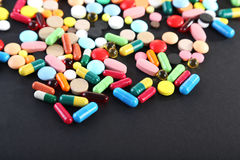 Colorful pills. Different colorful pills on black background Stock Photography