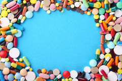 Colorful pills. Different colorful pills on blue background Stock Photography