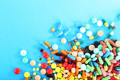 Colorful pills. Different colorful pills on blue background Royalty Free Stock Images