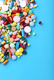Colorful pills. Different colorful pills on blue background Royalty Free Stock Photo