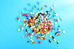 Colorful pills. Different colorful pills on blue background Royalty Free Stock Image