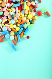 Colorful pills. Different colorful pills on mint background Royalty Free Stock Photography