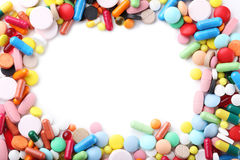 Colorful pills. Different colorful pills on white background Stock Photography