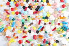 Colorful pills. Different colorful pills on white background Stock Images