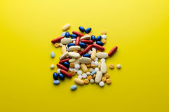 Colorful pills drugs and tablets. Pile of colorful pills drugs and tablets Royalty Free Stock Photo