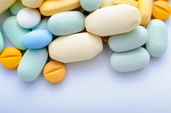 Colorful pills drugs and tablets. Pile of colorful pills drugs and tablets Stock Photos
