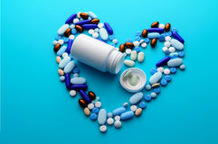 Colorful pills drugs and tablets. Colorful pills and tablets in shape of heart Stock Photo