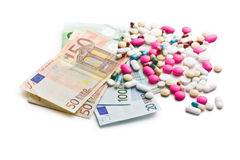 Colorful pills with euro bills. On white background Stock Photos