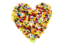 Colorful Pills In Heart Shape Stock Photography