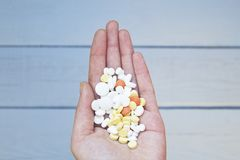Colorful pills and medicines in the woman hand. stock images