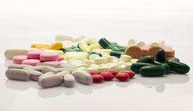 Colorful pills over white. Colorful and different pills over wihte background Royalty Free Stock Photography
